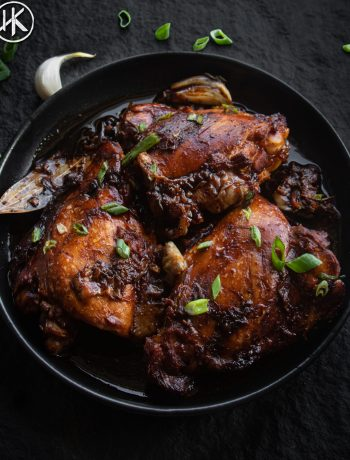 a plate of chicken adobo